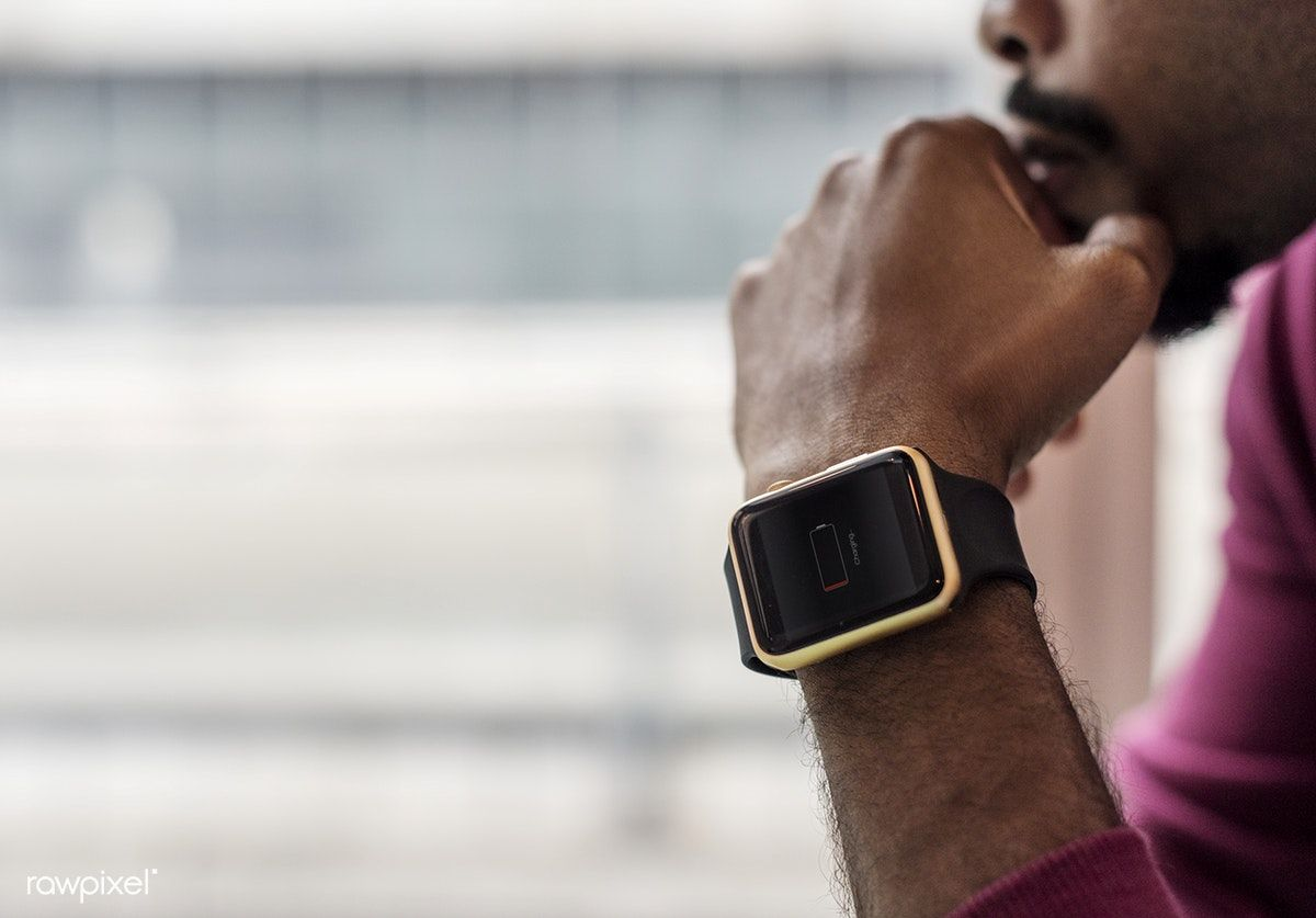black man wearing smartwatches